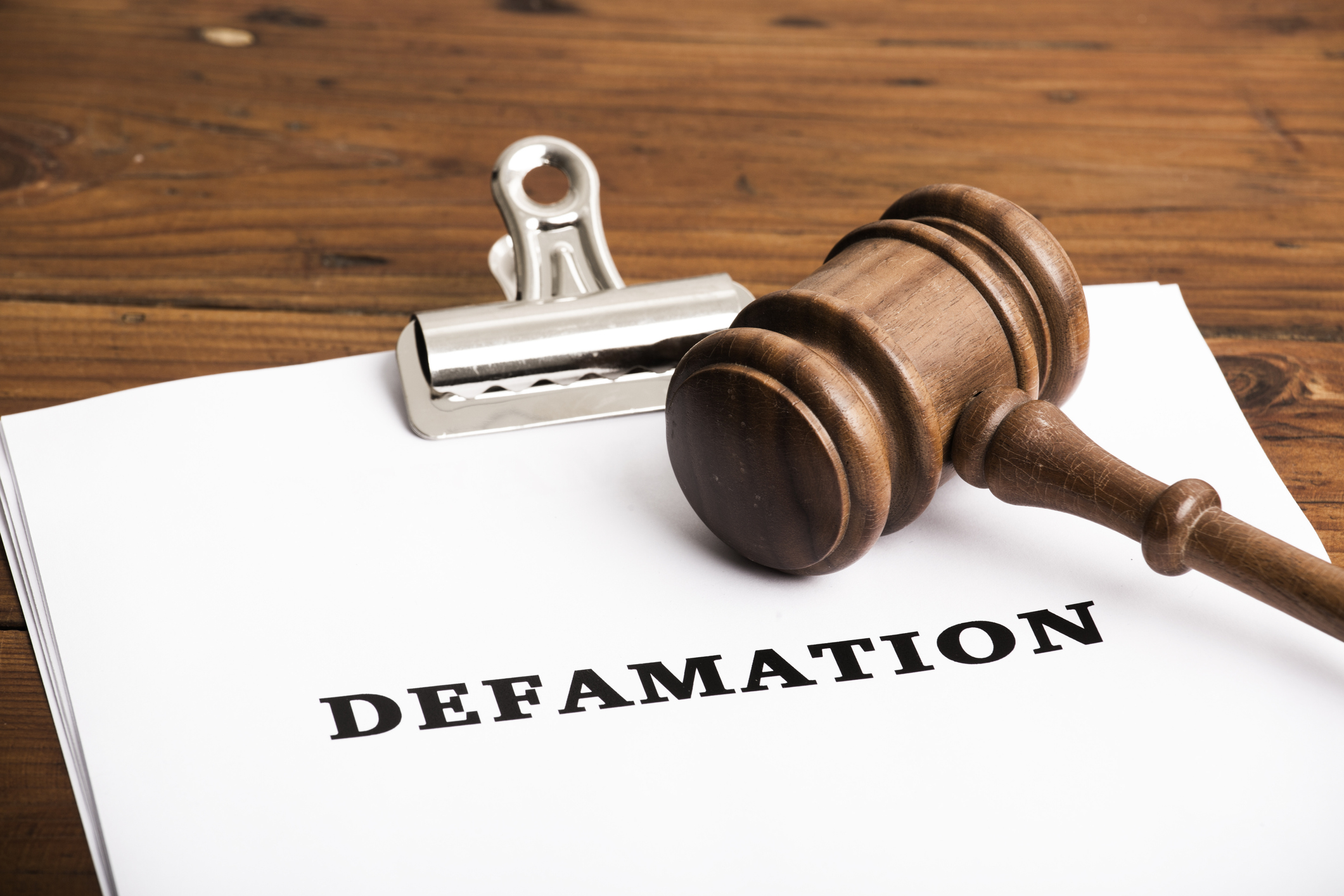 Defamation file in court with gavel