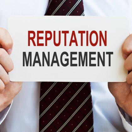 man holding reputation management card
