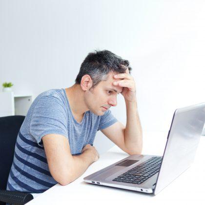 worried man at laptop
