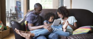 parents and children using an ipad