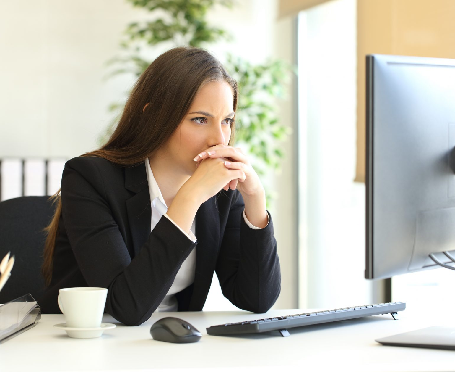 woman looks at computer