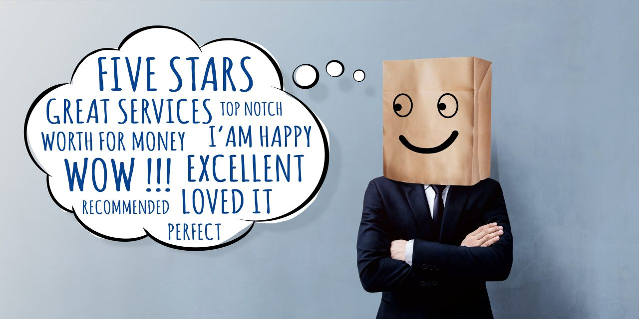 Happy Businessman Client with Smiley Emotion Face on Paper Bag, Crossed arms and looking at Wording of Positive Reviews on Think Bubble