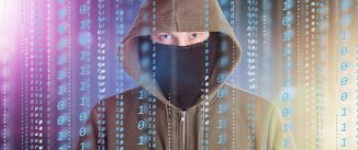 Hackers programmer look on screen and writes the program code hack information and user account