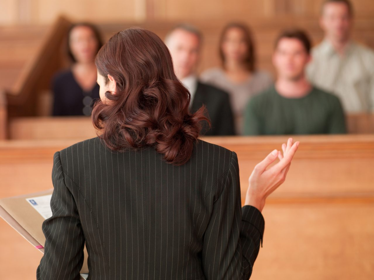 Female lawyer presenting her case to a jury