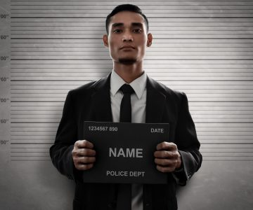 mugshot of man in a suit