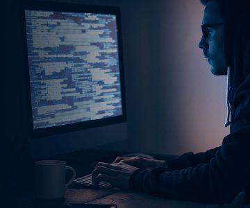 hacker looking at data screen