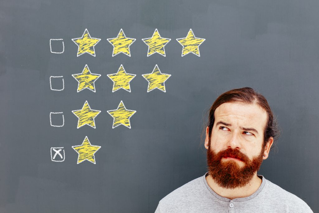 Bearded man looking up at star ratings