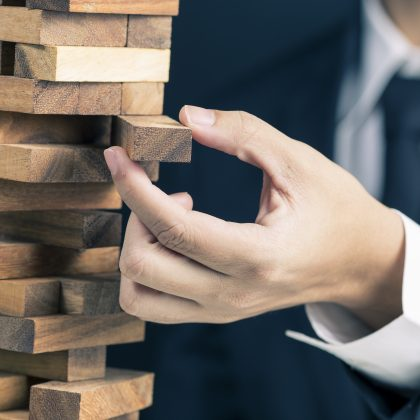 businessman playing jenga