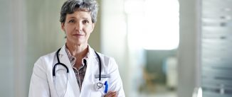 Portrait of a mature female doctor standing in a hospital corridor