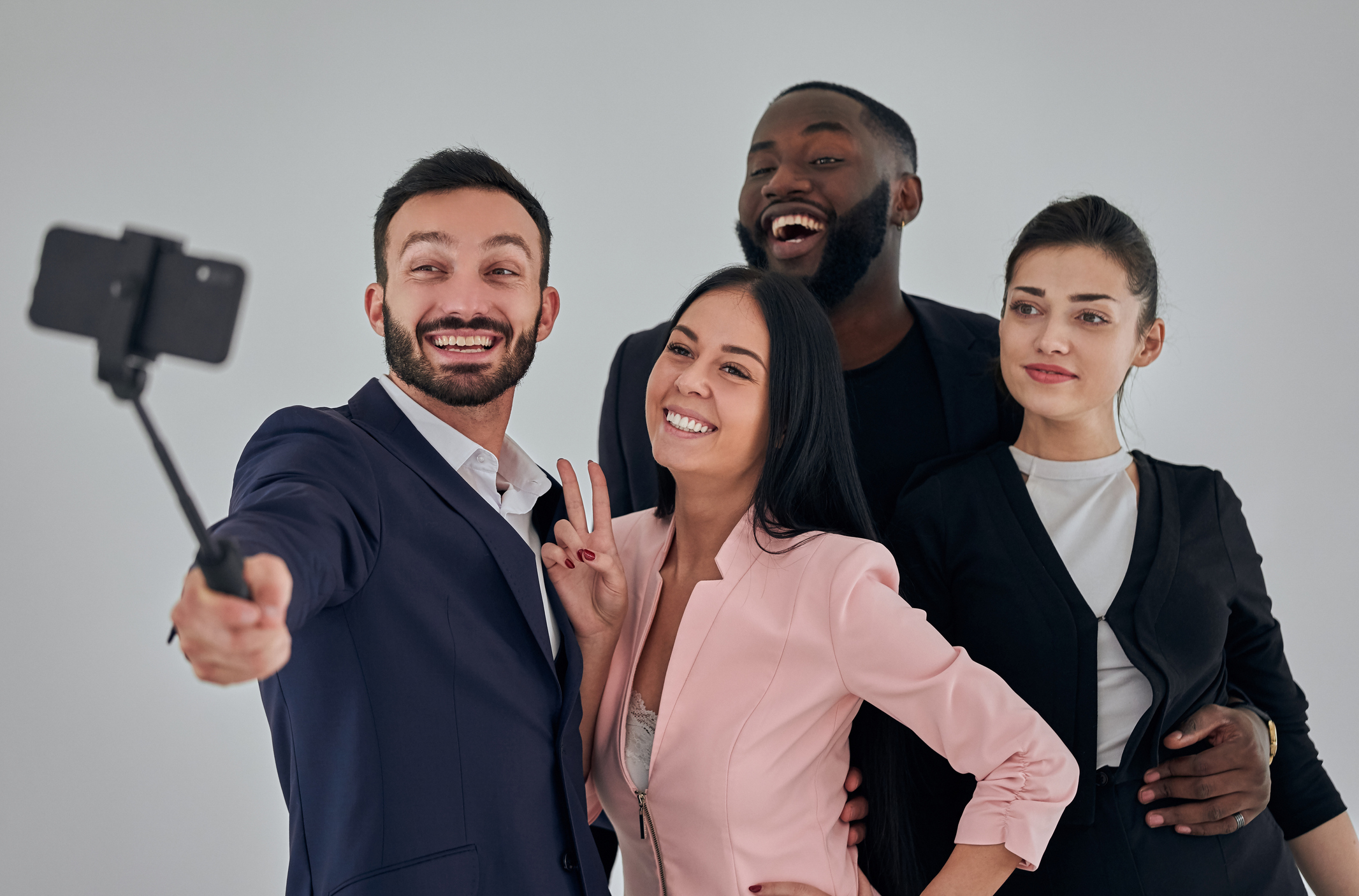 The four happy business people making selfie