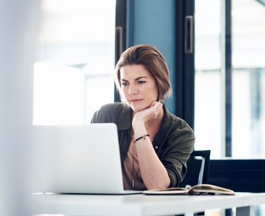 woman concentrating on a laptop screen