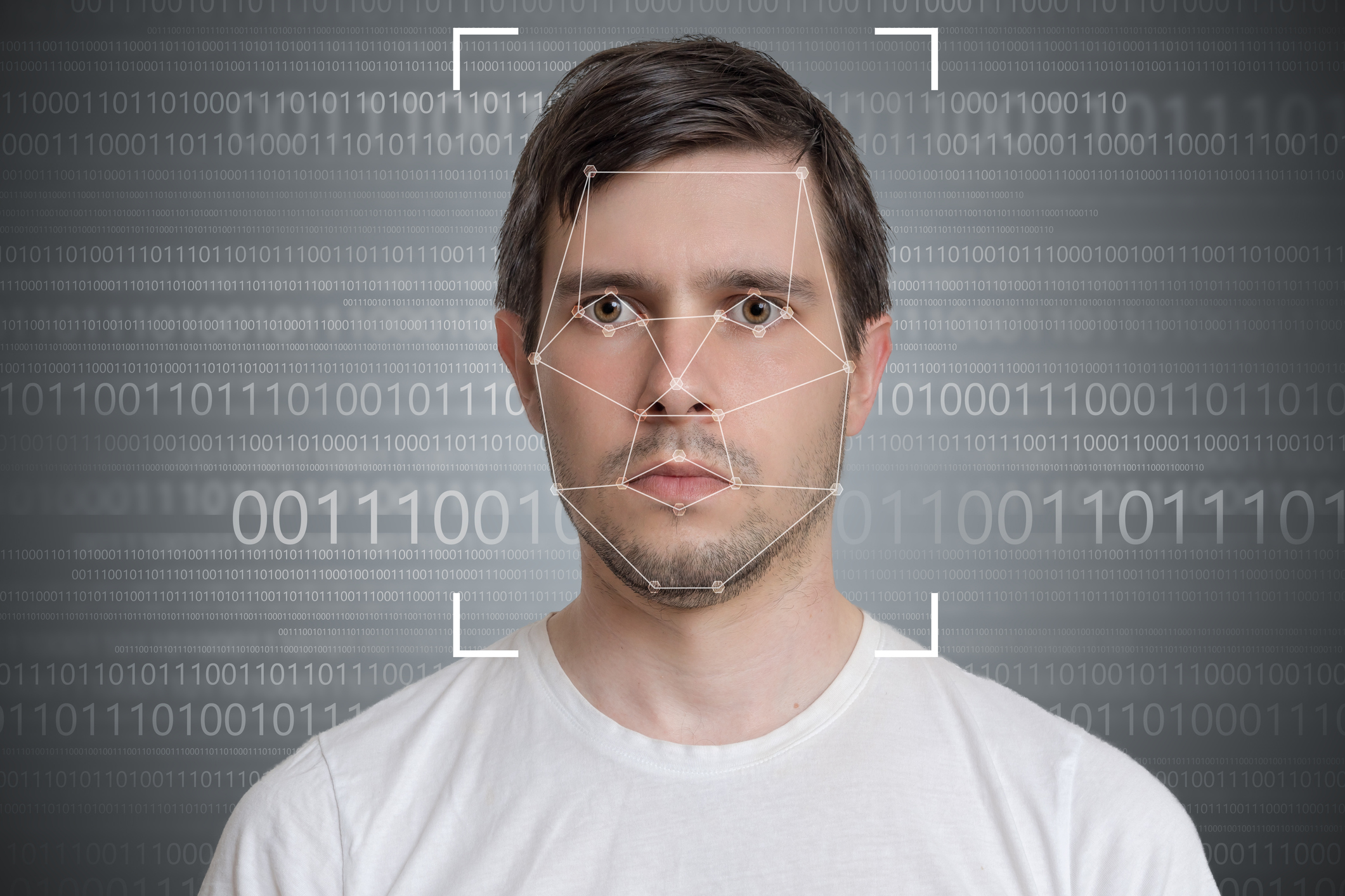 Face detection and recognition of man. Computer vision concept. Binary code in background.