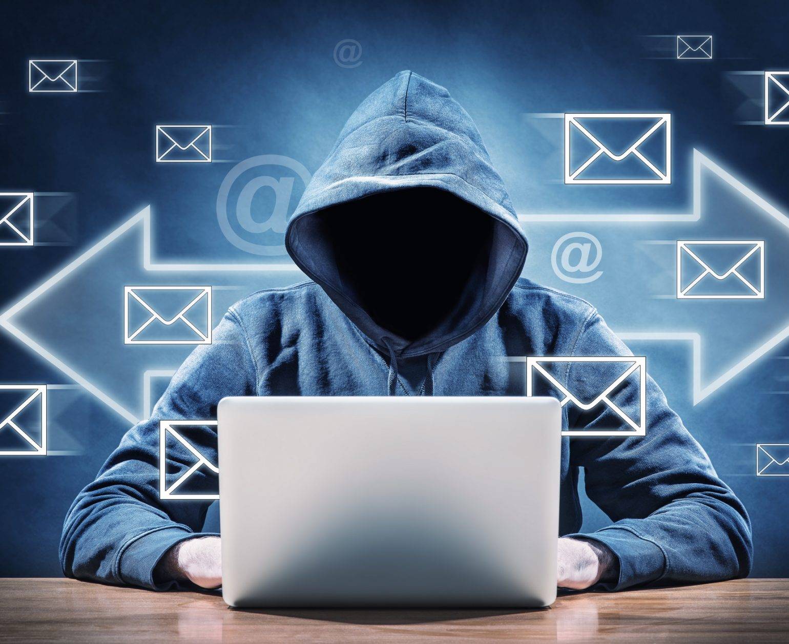 man on a computer surrounded by email icons
