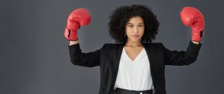 Business woman in red boxing gloves.