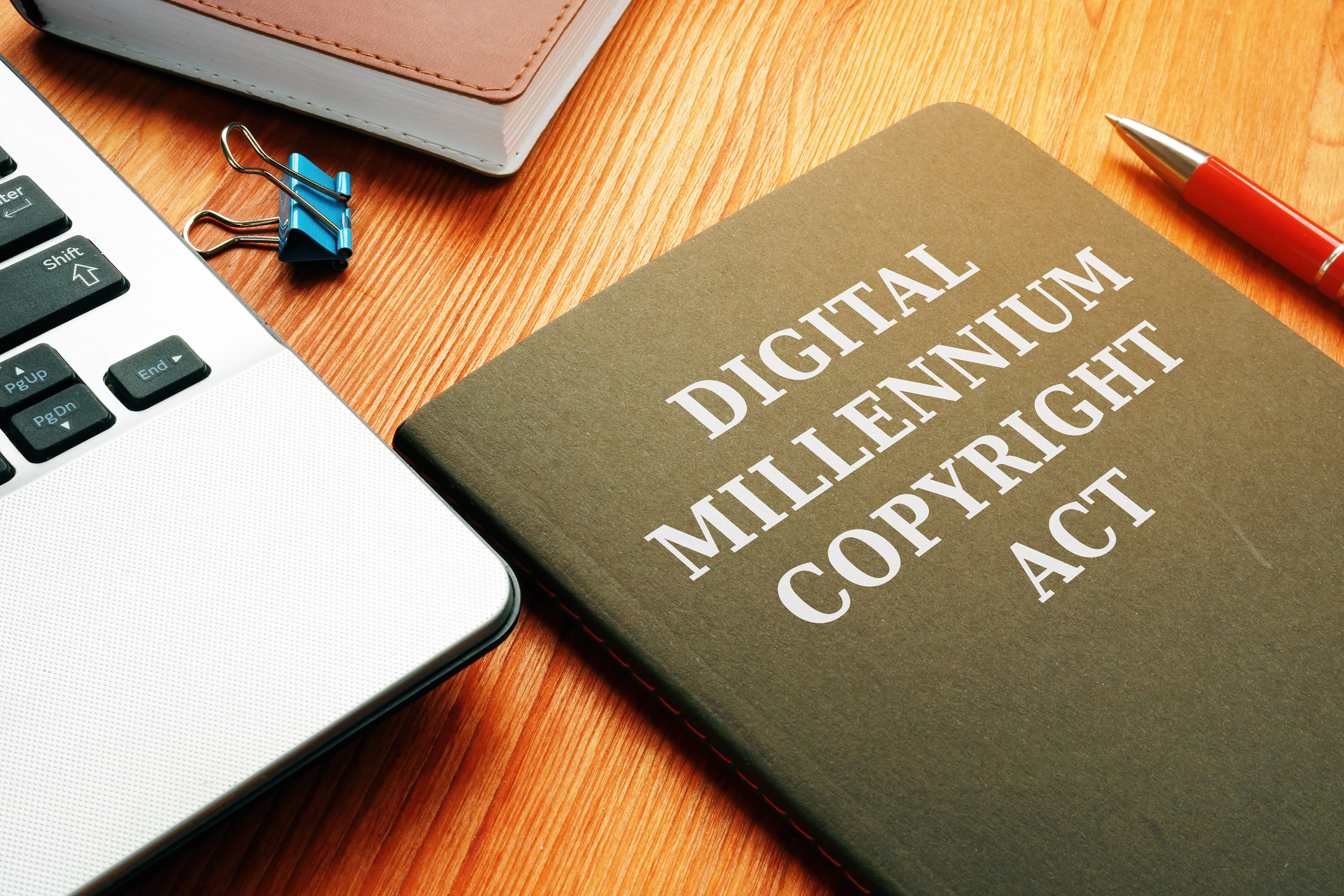 DMCA Digital Millennium Copyright Act and laptop.