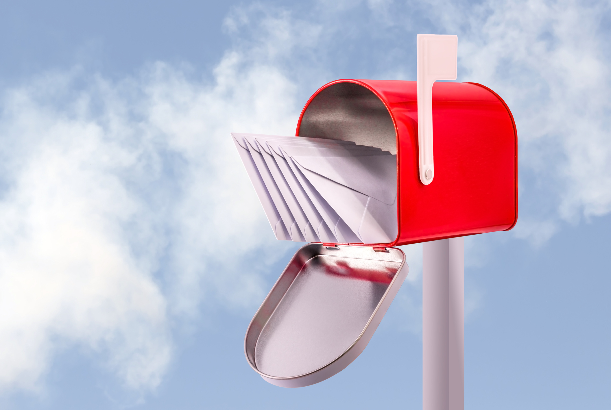 Red open mailbox with five white envelopes and sky background