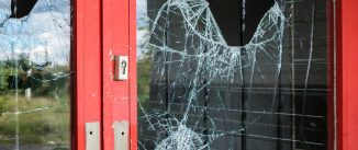 Broken glass in a business door