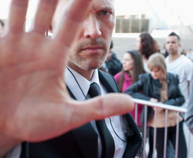 Bodyguard blocking camera