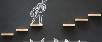 Hand-drawn chalk picture of an executive on steps over sharks with one step missing